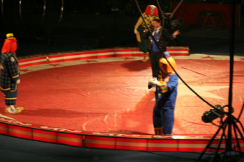 clowns and circus master in ring